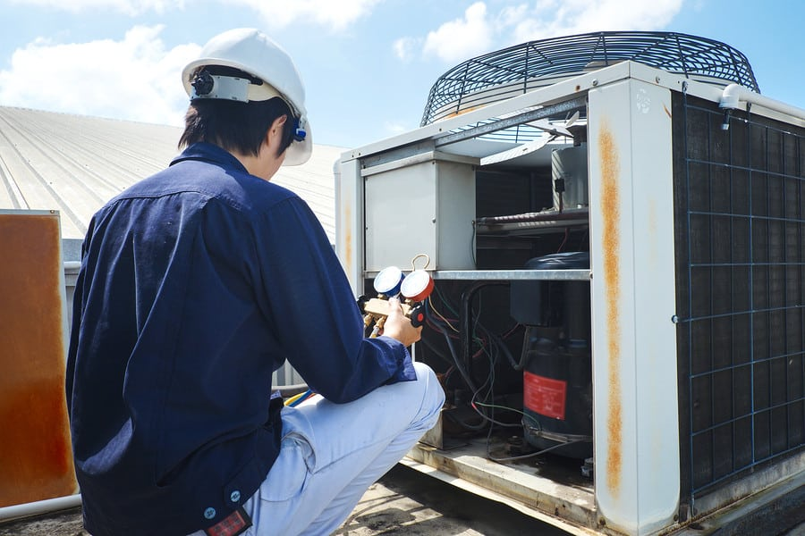 Irmo, SC Commercial HVAC contractor inspecting a rooftop unit on a commercial property