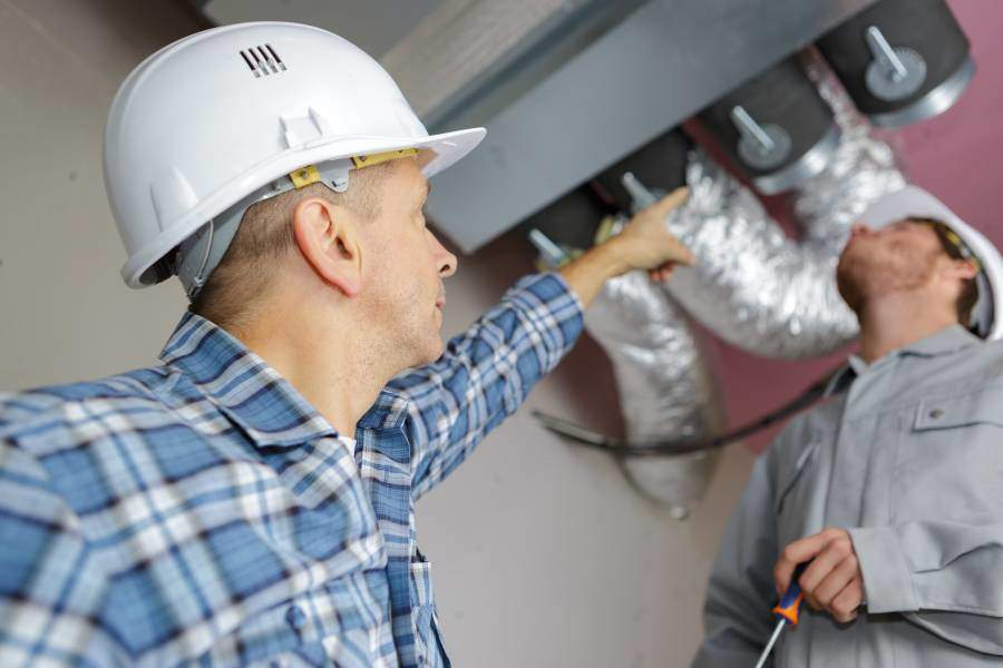 Evans Heating & Air Contractor Repairing Heating System