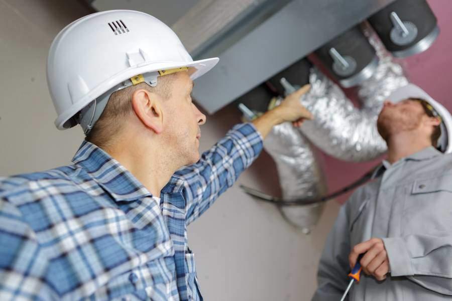 Evans Heating & Air Contractor Repairing Heating System