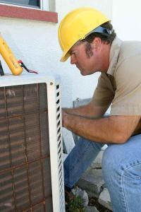 HVAC Contractor repairing an AC unit