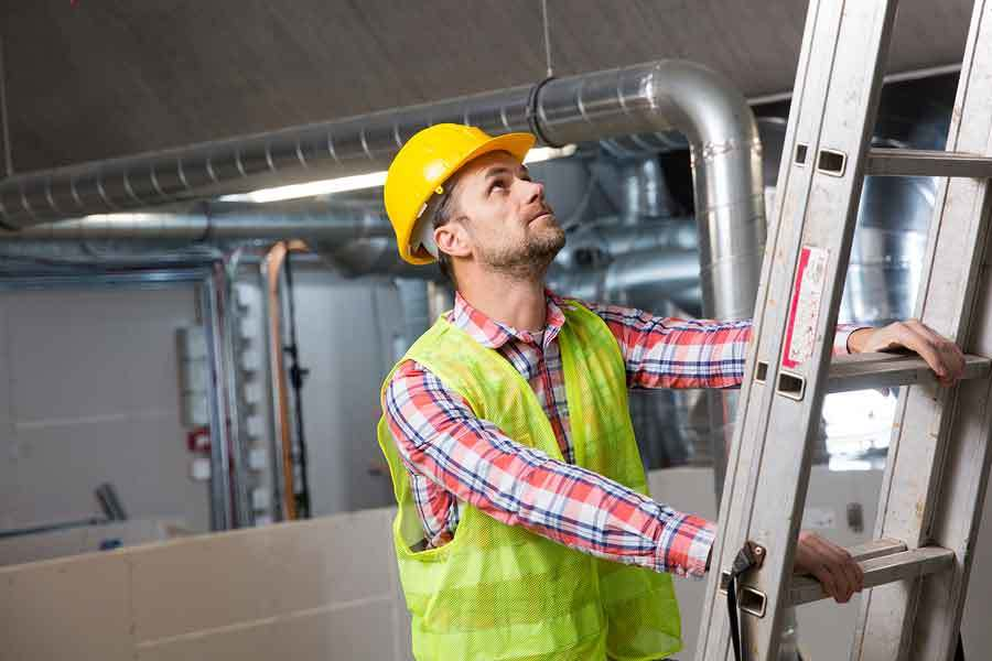 Commercial HVAC Contractor making repairs