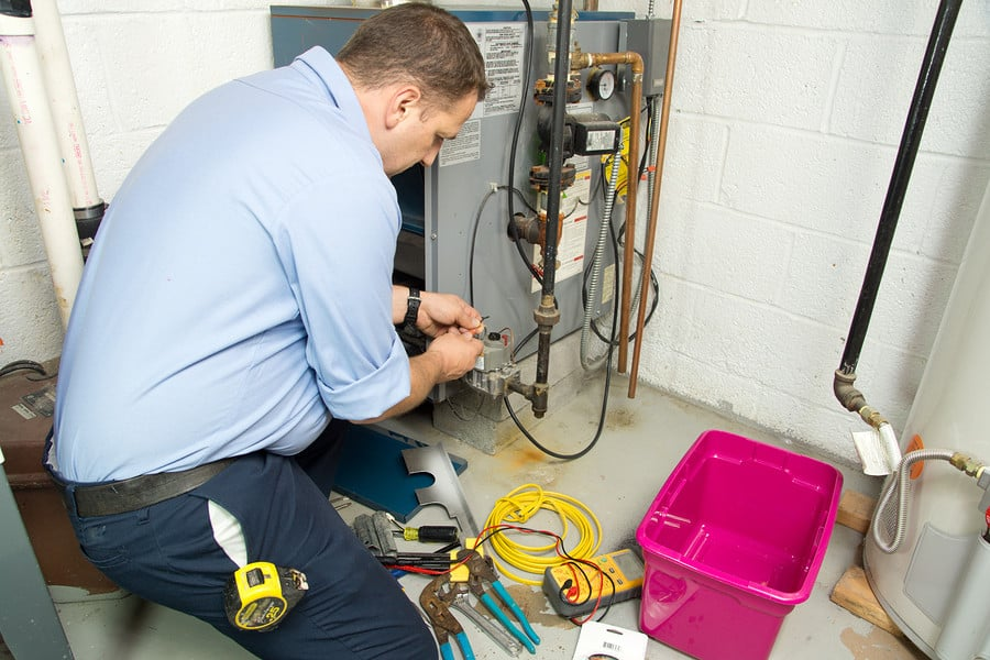 Evans Heating & Furnace Service by a Sig Cox HVAC Technician