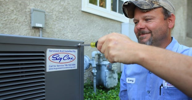 Sig Cox Technician repair an HVAC unit in Augusta, GA